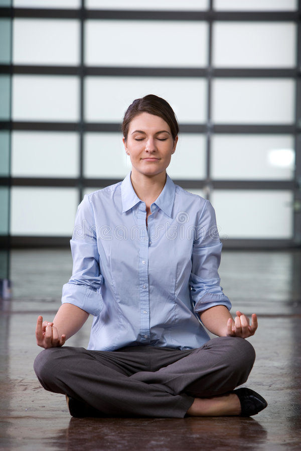 Business Woman Yoga At Work Royalty Free Stock Image