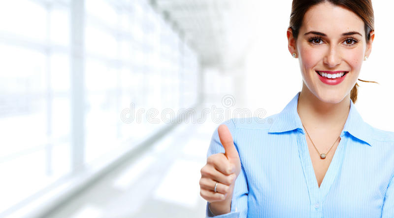Business woman. Young attractive smiling business woman over blue background stock image