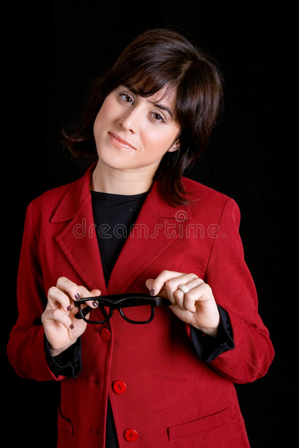 Business woman. Young business woman portrait on black background royalty free stock images