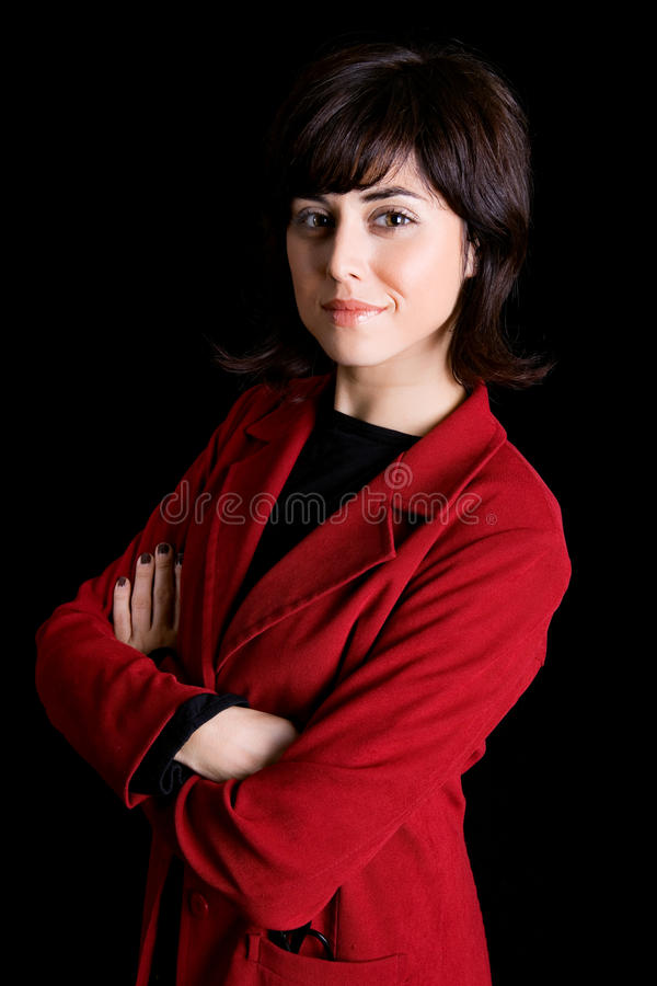 Business woman. Young business woman portrait on black background royalty free stock image