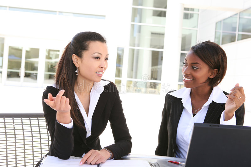 Business Women. An attractive women business team working with computer stock photos