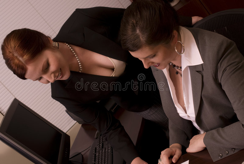 Business Women. Two Problem-Solving Corporate Co-Workers royalty free stock photos