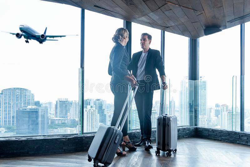 Business women and businessmen leave luggage and meet at the airport to fly to see work in foreign countries. Two people holding passport and see the airplane stock photos