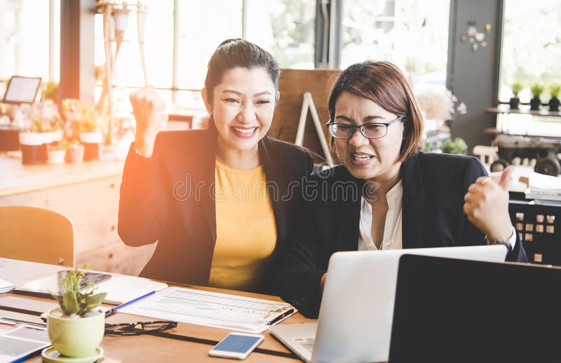 Business women celebrating good project results. stock image