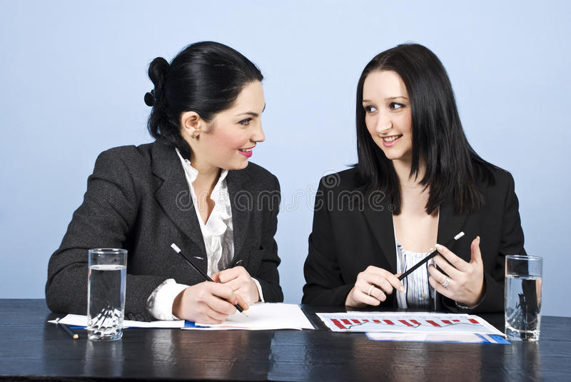 Business women conversation at meeting. Two young business women having an conversation at meeting,check also stock photo