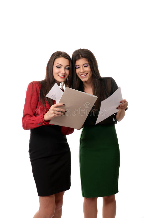 Business women doing paperwork royalty free stock photography