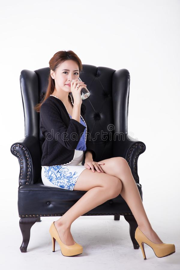 Business women drinking in a chair royalty free stock photos