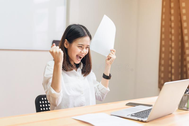 Business women fists being excited of success expressed joy because they work to achieve her goals. royalty free stock photos