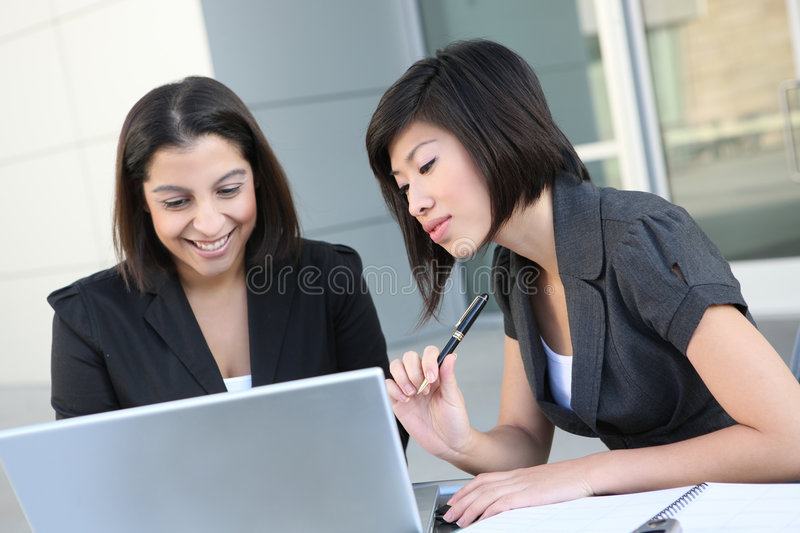 Business Women (Focus on Asian Woman). An attractive business team meeting at office (Focus on Asian Woman royalty free stock photo
