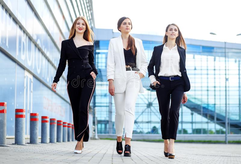 Business women go to the office center. Concept for business, boss, robot, team and success stock image