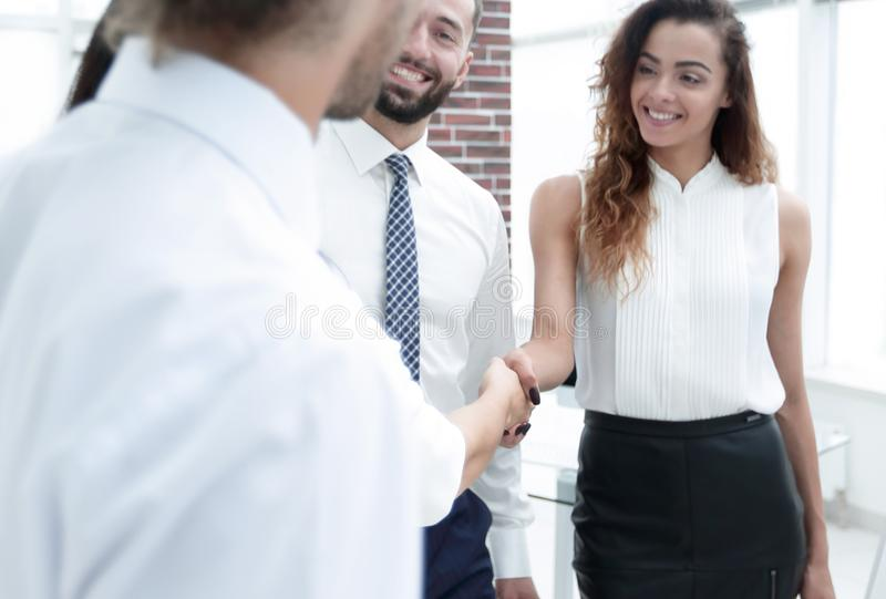 Business women greet each other with a handshake. Before the start of the presentation stock photo