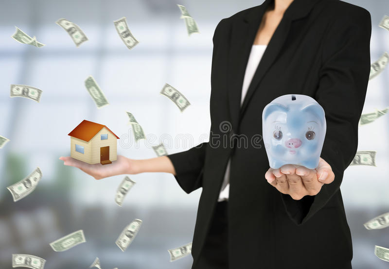 Business women hand holding piggy bank and home. Concept saving finance and investment mortgage stock images