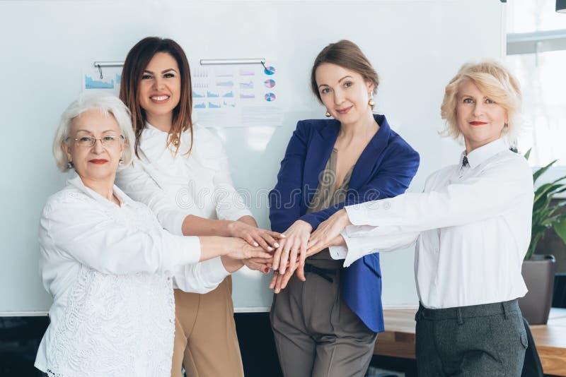 Business women hands together teamwork diversity. Business women hands together. Equality unity. Cooperation collaboration teamwork. Diversity strength success stock images