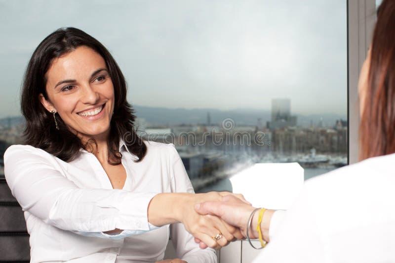 Business women handshake stock photos