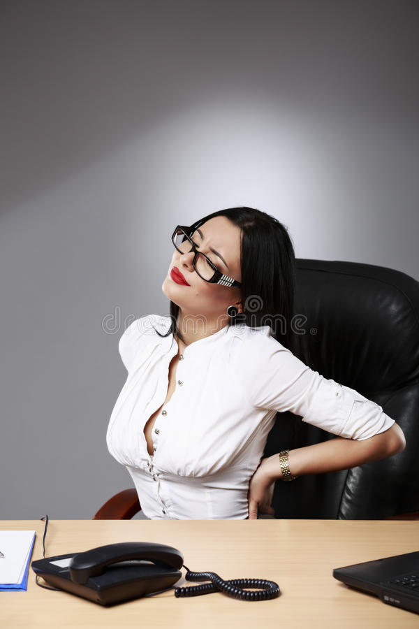 Business women having back pain royalty free stock photo