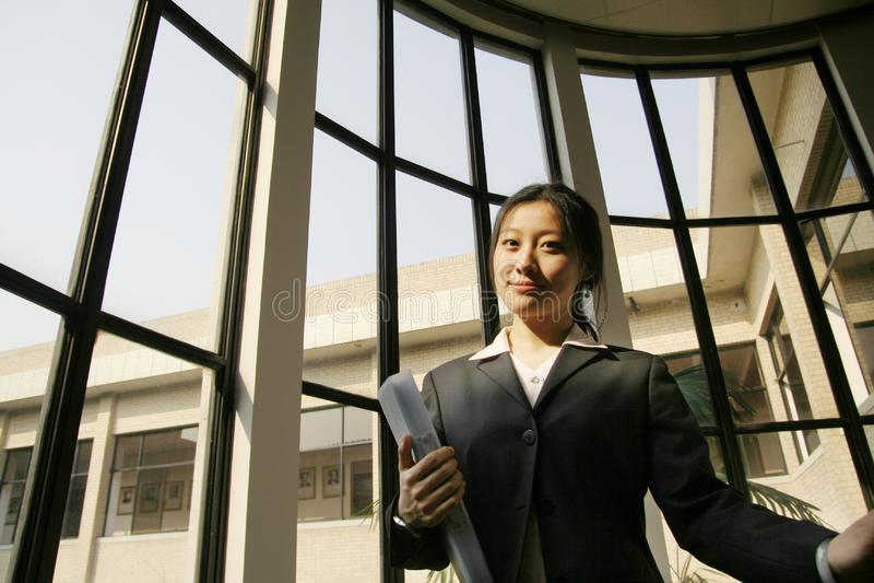 Business women holding folder royalty free stock images