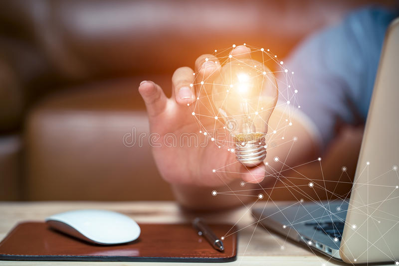Business women holding light bulbs, ideas of new ideas with innovative technology and creativity. stock photography