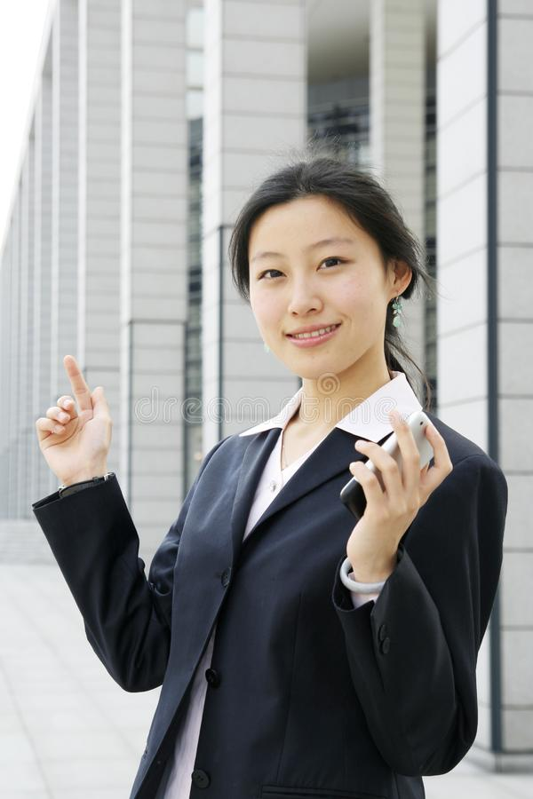 Business women holding a mobile phone stock images