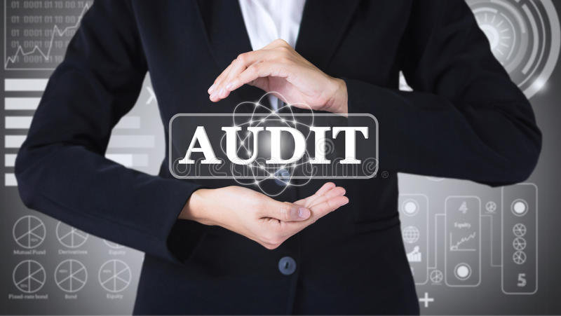 Business women holding posts in AUDIT. stock photography