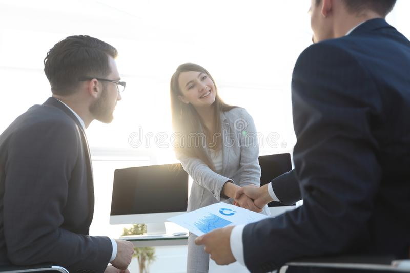 Business woman and investor with a handshake. stock photos