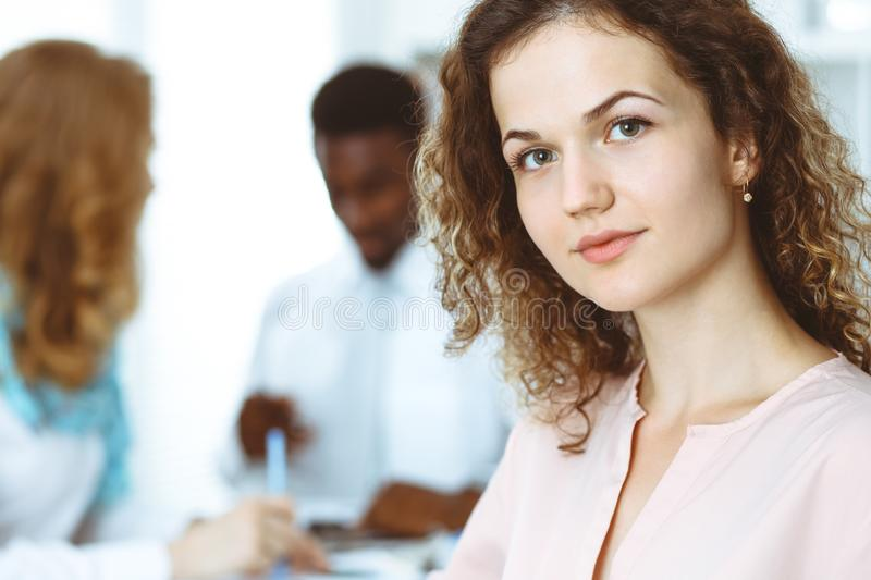 Business woman at meeting in office, colored in white. Multi ethnic business people group royalty free stock photos