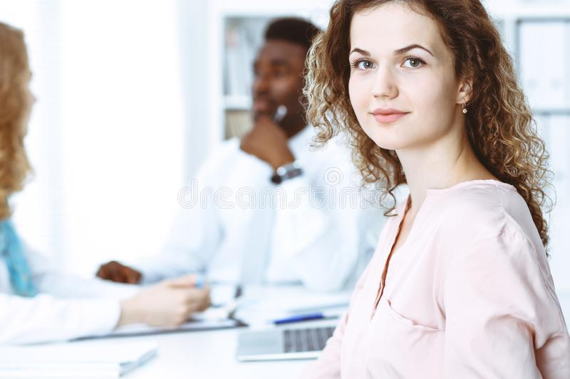 Business woman at meeting in office, colored in white. Multi ethnic business people group stock photos