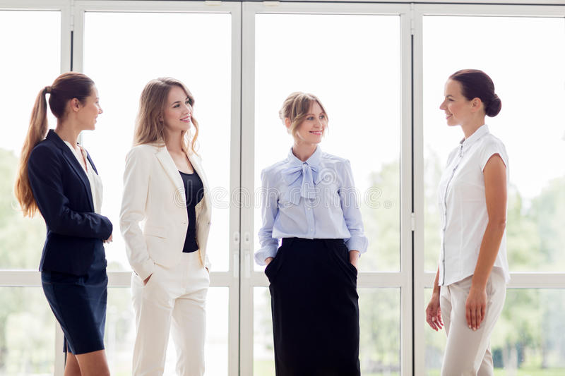 Business women meeting at office and talking. People, work and corporate concept - business women meeting at office and talking royalty free stock photo