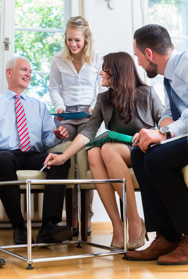 Business women and men having presentation in office stock image