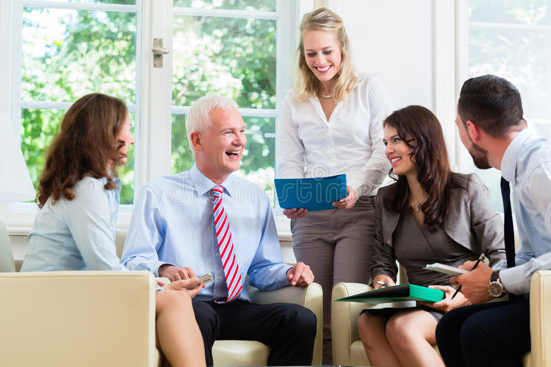 Business women and men having presentation in office royalty free stock photo