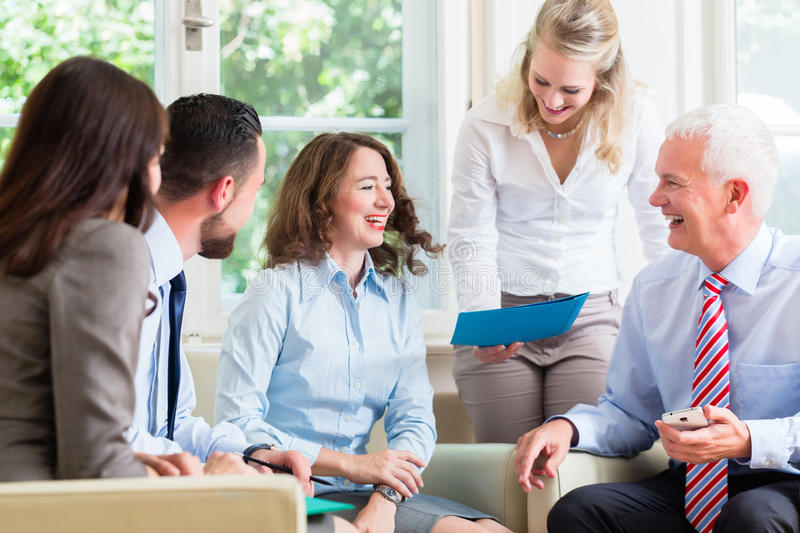 Business women and men in office having presentation royalty free stock image