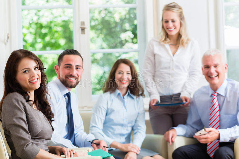 Business women and men in office having presentation royalty free stock photography
