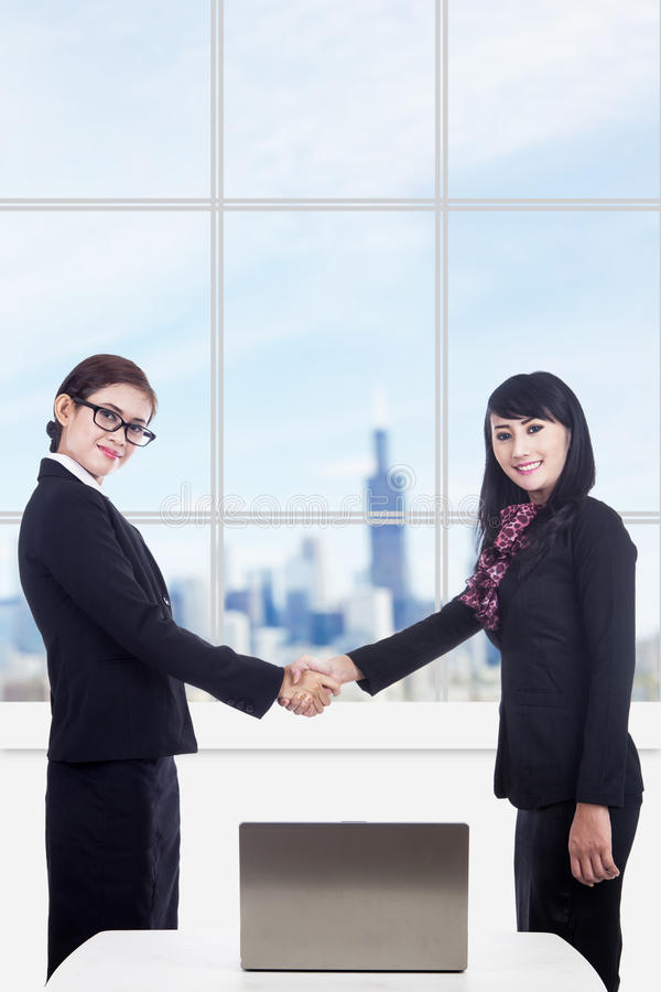 Business women partnership with laptop in office royalty free stock image