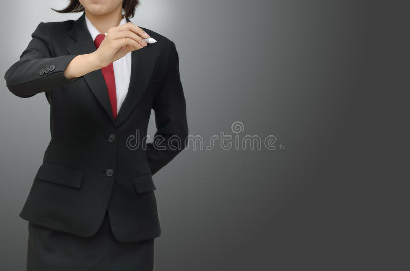 Business women with pen on gray background. Close up Business woman with pen on gray background royalty free stock images