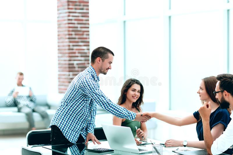 Business woman shaking hands with her business partner. Business women shaking hands with her business partner.concept of cooperation royalty free stock photography