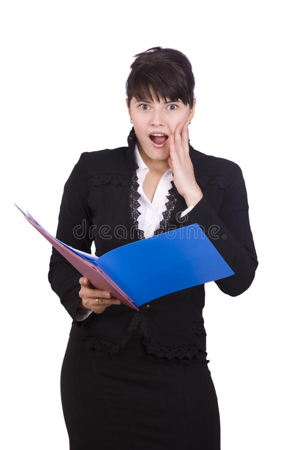 Business women is shocked by the finances report. Business women looks up from finances account with an anguished expression on her face. A pretty brunette stock images