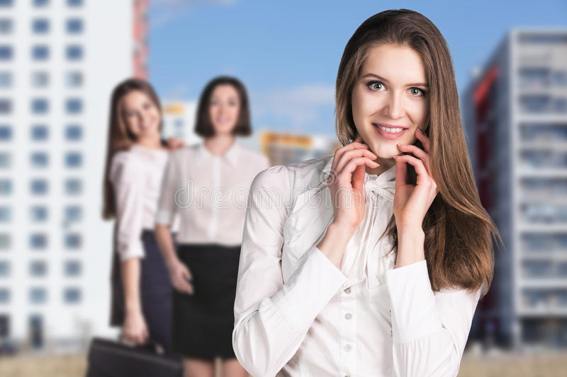 Business women stand on the street stock photography