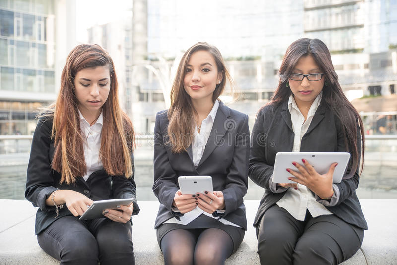Business women with tablets stock photos