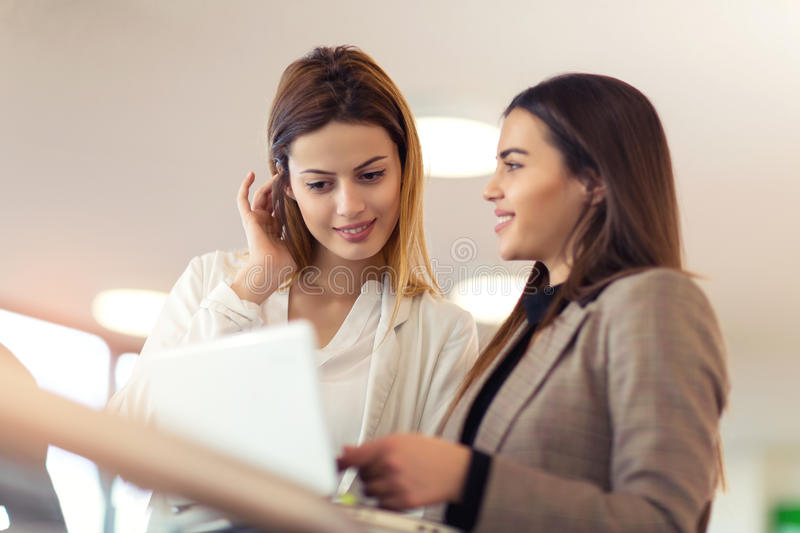 Business women talking at office building royalty free stock photo