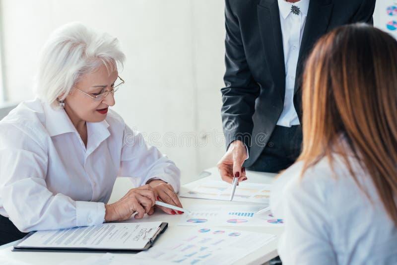 Business women teamwork analysis brainstorming royalty free stock photos