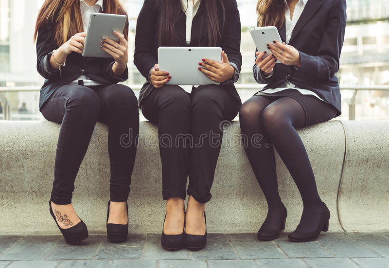 Business women. Three business women working outdoor on their laptop stock images
