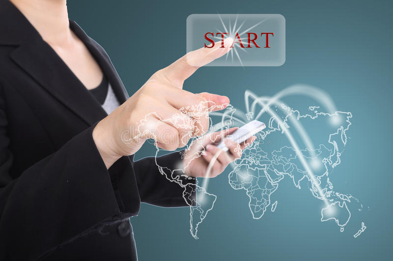 Business women Touch button start focus on global market concept. With global map background stock photos