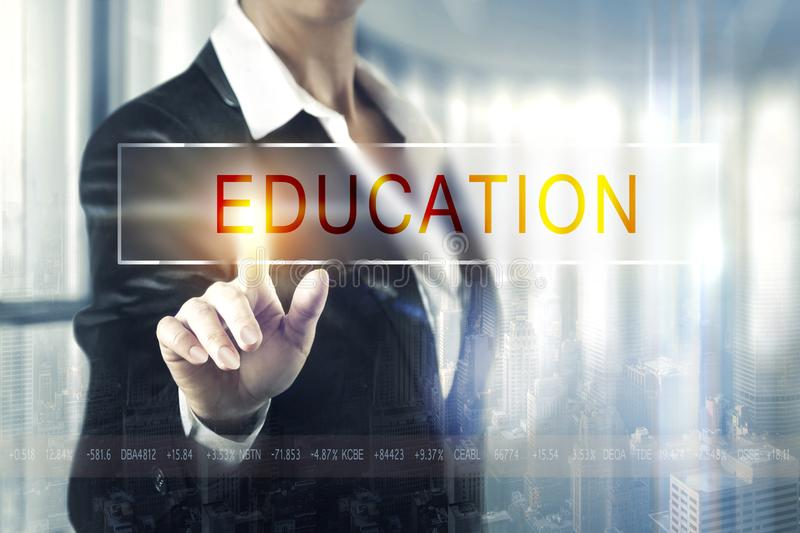 Business women touching the education screen royalty free stock images