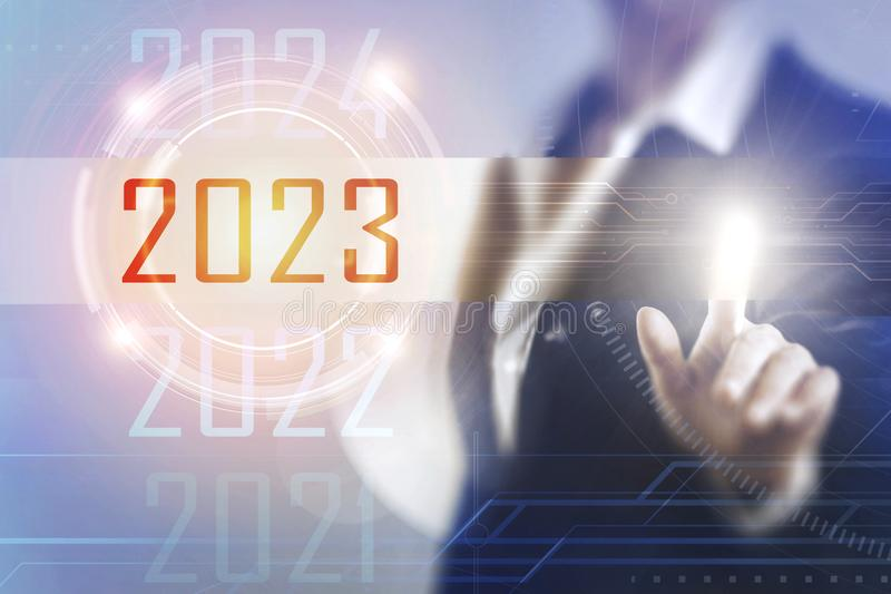Business women touching the 2023 screen stock illustration