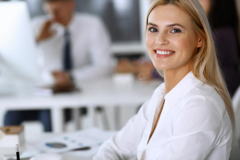 Business woman using computer at workplace in modern office. Secretary or female lawyer smiling and looks happy. Working. Business women using computer at stock images