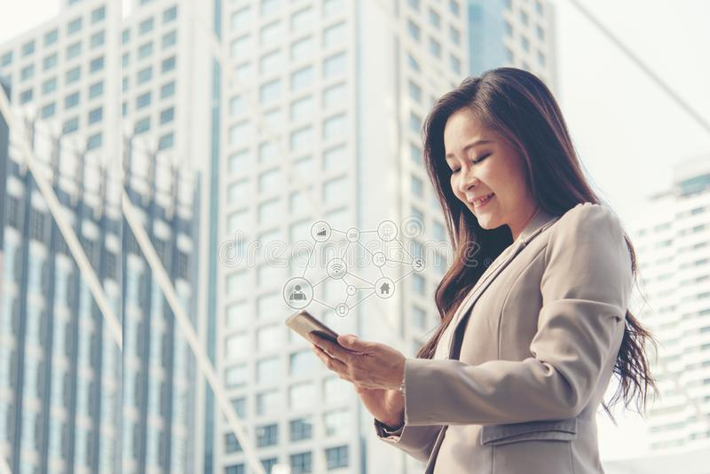 Business women using social network connection modern city background. stock images