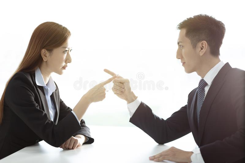 Businesswoman VS business man arm wrestling stock photos