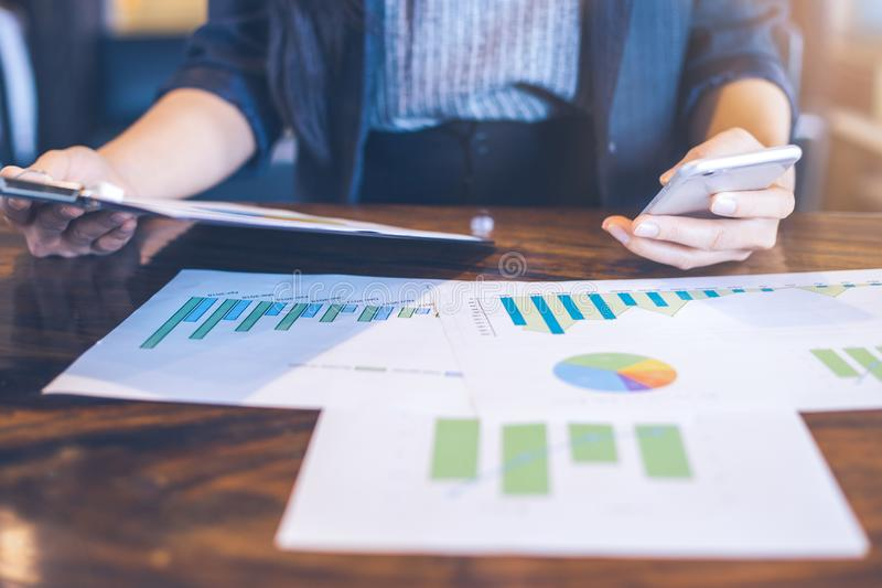 Business women work on statistics and business graphs. stock photos
