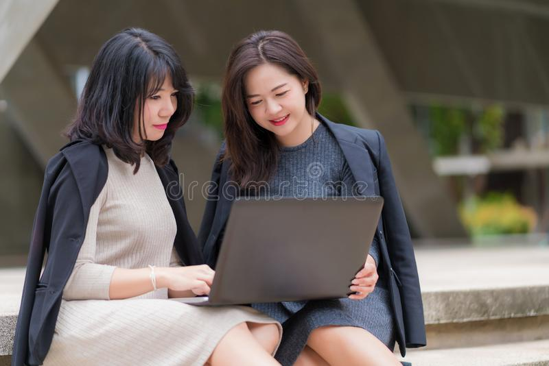 Business woman working together with laptop at office building stock photos