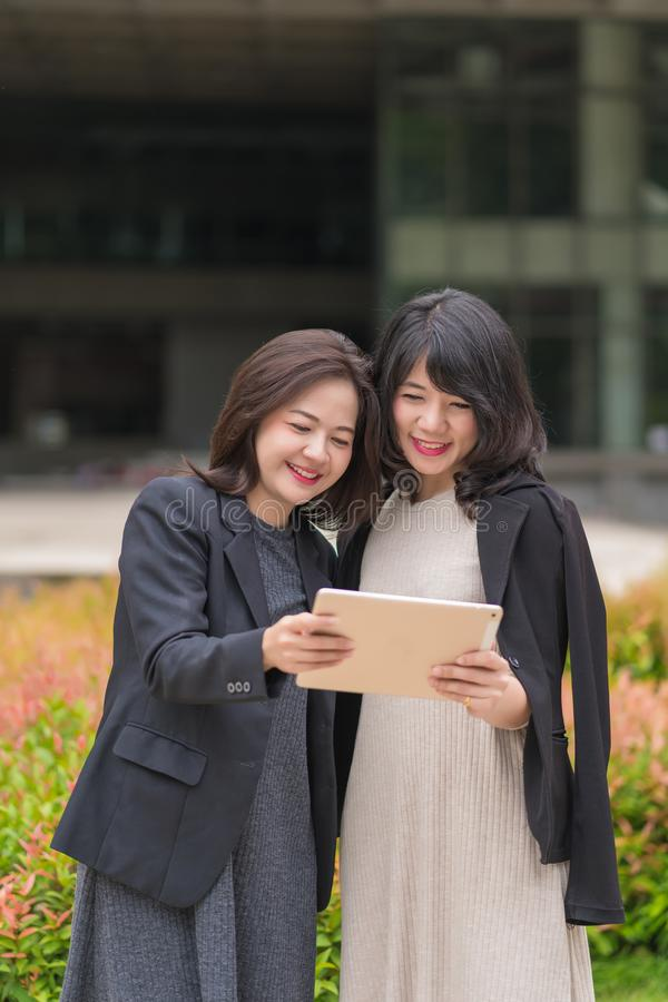 Business woman working together with tablet at office building royalty free stock image
