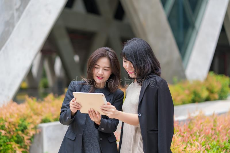 Business woman working together with tablet at office building stock images